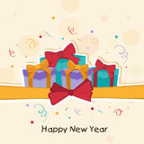 Poster or banner for New Year celebrations. Happy New Year celebration with wrapped gift boxes on stylish beige background Royalty Free Stock Images