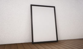 Poster with black frame mockup standing on the floor. 3d renderi Royalty Free Stock Photo