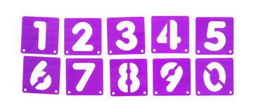 Poster board stencil templates numbers in a row. A group of numbers in purple poster board stencils in a messy row isolated on a white background Stock Photography
