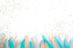 Feathers for a carnival costume. Colored confetti. White backgro. A poster for a Brazilian carnival, a party or a bachelorette party Royalty Free Stock Photography