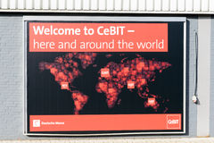 A poster of the CeBIT at a wall inside the trade fair ground advertises for CeBIT events worldwide Royalty Free Stock Images