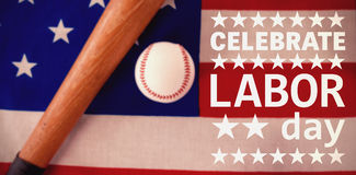 Composite image of poster of celebrate labor day text. Poster of celebrate labor day text against baseball bat and ball on american flag Royalty Free Stock Image