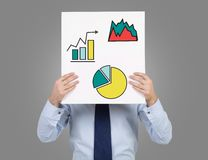 Poster with charts. Businessman holding poster with charts Royalty Free Stock Images