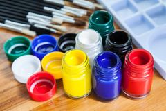 Poster Color bottle, Brush, Palette with art for kid on wood.  royalty free stock photography