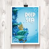 Poster with the deep sea anemones in the binder on the wood Stock Photo