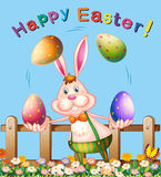 Poster design with easter bunny juggling eggs Stock Photography