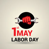 Poster design with text 1st May Labor Day. Poster, banner or flyer design with stylish text 1st May Labor Day and illustration of human hand fist holding wrench Royalty Free Illustration
