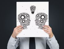 Poster with drawing head. Businessman holding poster with drawing head Royalty Free Stock Photography