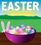 Poster Easter eggs in a plate on a wooden table. Bunny peeps.  Royalty Free Stock Image