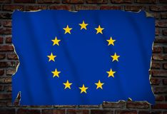 Poster with the EU flag on a brick wall royalty free stock photo