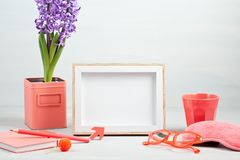 Poster frame with decor elements in living coral color. Poster frame mockup, front view, with decor elements in living coral color, flowers and blank copy space stock image