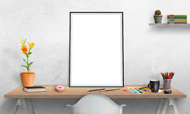 poster frame and laptop on office desk for mockup. Poster frame on office desk for mockup. Water colors, pencils, glasses, flowers, cup of coffee on table Stock Image