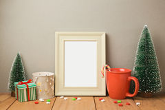 Poster frame mock up template for Christmas holiday greeting presentation. With cups and small pine trees Stock Photography