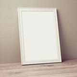 Poster frame mock up template on wooden floor Royalty Free Stock Photo