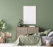 Poster frame mockup in Farmhouse Bedroom, green room interior design with natural wooden furniture