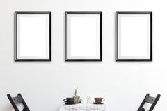 Poster Frame. Three mock up poster frame in coffee corner interior background Royalty Free Stock Photos