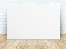 Poster frame at tiles ceramic wall and wooden floor Stock Photo