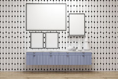 Poster gallery, blue drawers, gray wall. Poster gallery in a room with white stripes on gray wall. There are framed posters standing on a blue set of drawers. 3d Royalty Free Stock Image
