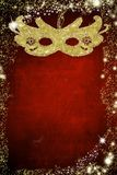 Carnival mask on gold and red background Stock Images