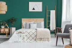 Poster in green bedroom interior Stock Photos