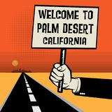 Poster in hand, text Welcome to Palm Desert, California Royalty Free Stock Photos