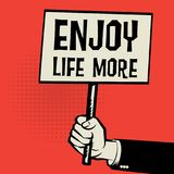 Poster in hand, business concept with text Enjoy Life More Stock Photography