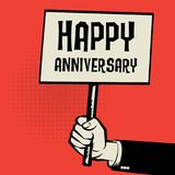 Poster in hand, business concept with text Happy Anniversary Royalty Free Stock Image