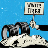 Poster in hand, business concept with text Winter Tires Stock Photo