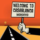 Poster in hand, text Welcome to Casablanca, Morocco Royalty Free Stock Images
