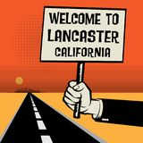 Poster in hand, text Welcome to Lancaster, California Stock Images