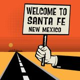 Poster in hand, text Welcome to Santa Fe, New Mexico Royalty Free Stock Photos