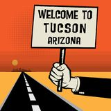 Poster in hand, text Welcome to Tucson, Arizona Royalty Free Stock Photography