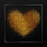 Poster with heart from gold dust, confetti, sparkles, golden glitter in black glass frame, border on black background Stock Image