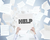 Poster with help. Hand holding poster with help and falling documents Stock Images