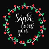 Santa loves you. Christmas holiday  print. Winter card or poster design. Poster, invitation, greeting card or t-shirt. Vector calligraphy design. Christmas Royalty Free Stock Photos