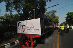A poster of Joko Widodo-Kalla in front of a steam train Royalty Free Stock Images