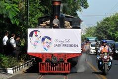 A poster of Joko Widodo-Kalla in front of a steam train Stock Photos