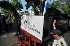 A poster of Joko Widodo-Kalla in front of a steam train Stock Photo