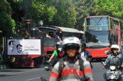 A poster of Joko Widodo-Kalla in front of a steam train Royalty Free Stock Photos