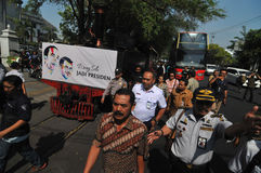 A poster of Joko Widodo-Kalla in front of a steam train Stock Photography