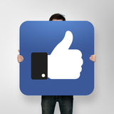 Poster with like icon. Man holding poster with like icon royalty free stock photo