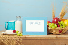 Poster mock up template for Jewish holiday Shavuot. Milk and fruits on wooden table. Stock Image