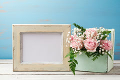 Poster mock up template with rose flower bouquet in box stock photography
