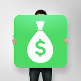 Poster with money icon with bag. Man holding poster with money icon with bag Royalty Free Stock Photos