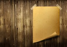 Poster old paper. Stick tape on old wood background royalty free stock photos