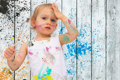 Poster paintings 2. Two-year old girl paints with poster paintings Stock Photography
