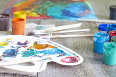 Poster paints watercolor with brushes abstract concept Stock Photography