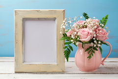 Poster or photo frame mock up template with rose flower bouquet in pink vase Royalty Free Stock Photo