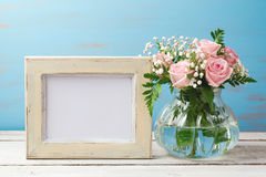 Poster or photo frame mock up template with rose flower bouquet royalty free stock photography