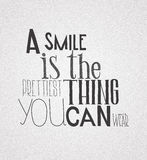 Poster  quote  A smile is the prettilest thing you can wear Stock Photos